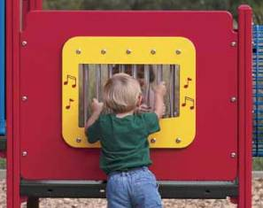 Child plays with chime panel at playground